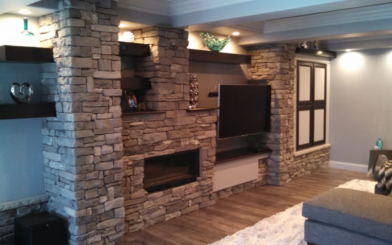 fireplace and tv stone wall