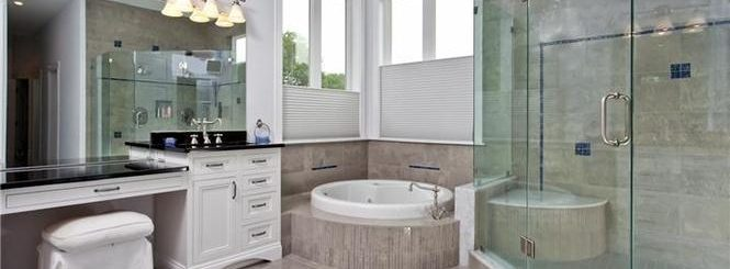 full bathroom renovation with glass details and natural light