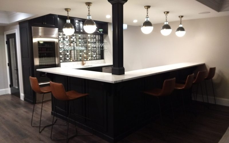 bar and seating in finished basement