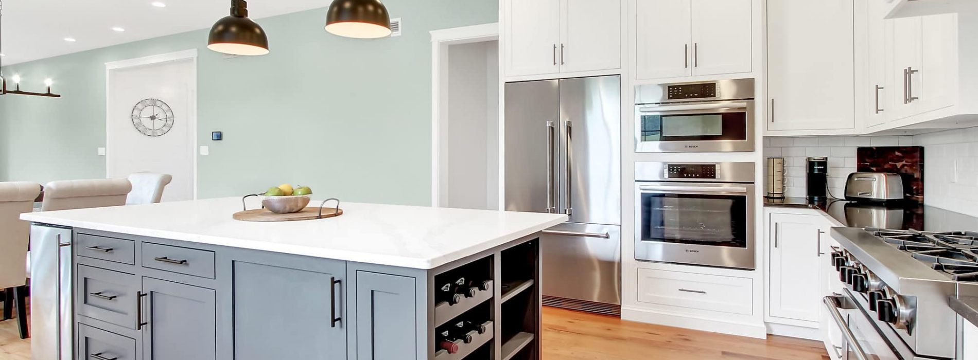 renovated kitchen with white cabinets