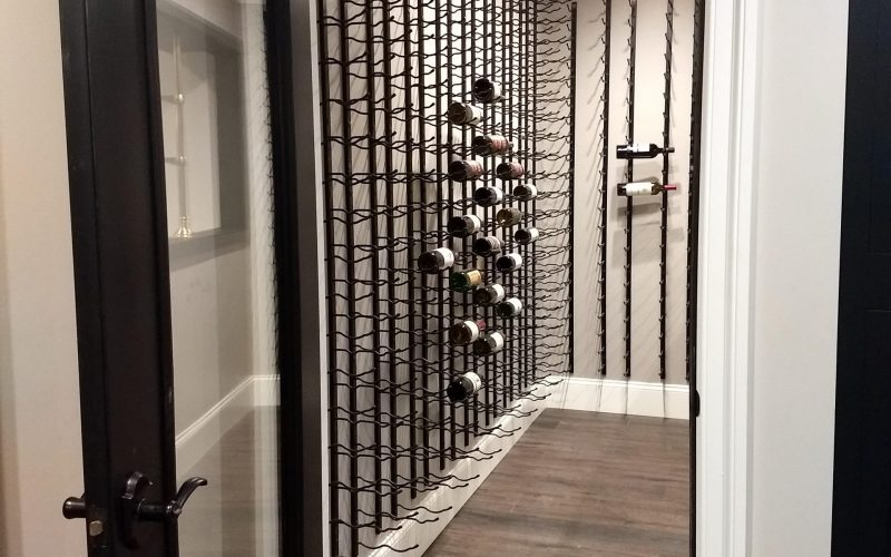 doorway to wine racks in finished basement