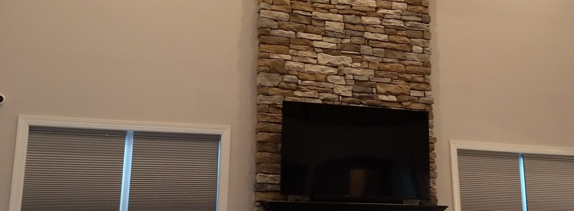 tv mounted on new fireplace