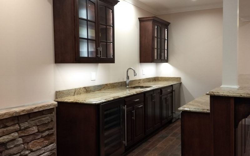 sink and cabinets and counters in finished basement