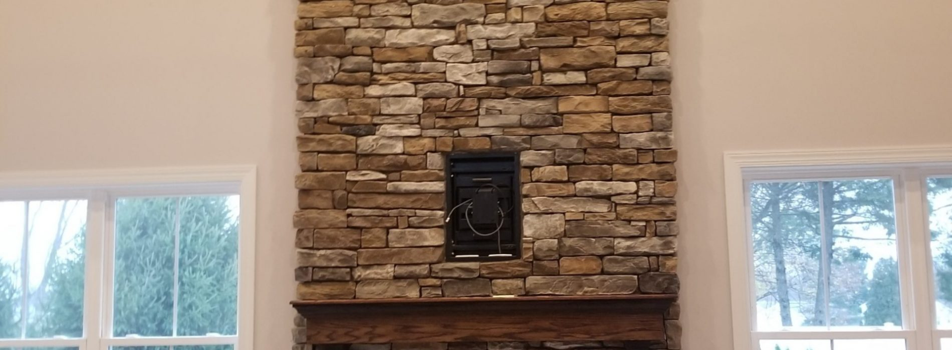 new stone work on living room fireplace