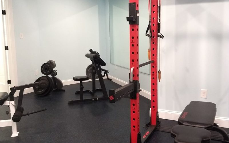 exercise equiptment in a finished basement
