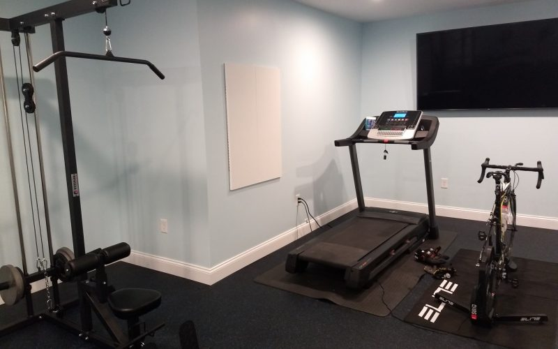 aerobics exercise equiptment in front of tv