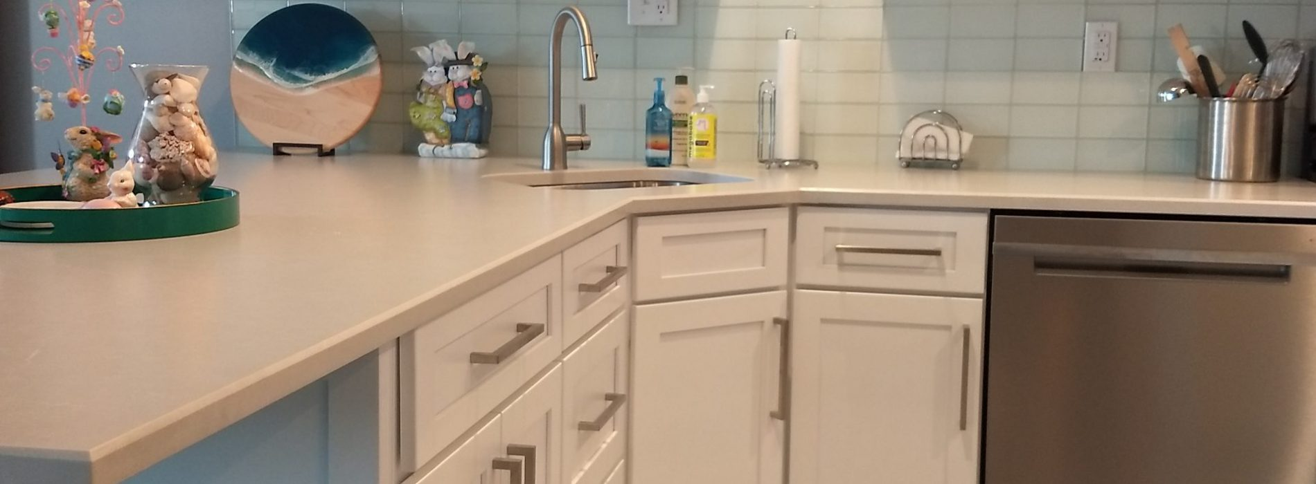 renovated kitchen cabinets and decorative shelving