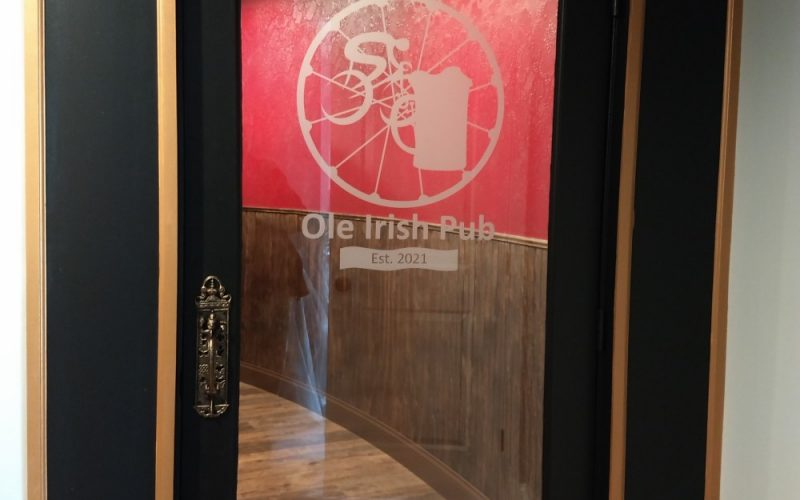 glass door to the spoke and ale old irish pub